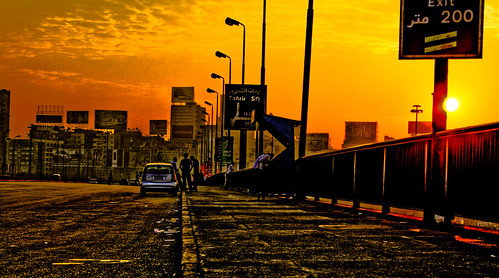 street bridge people orange sun cars car yellow clouds digital sunrise buildings river ads square geotagged rebel xt traffic panel banner eid egypt nile cairo 200 parked meter exit banners digitalrebelxt hdr hdri advertisments lightroom photogallery tahrir 3xp photomatix flickrexplore 6october aeb flickrelite korayem geo:lat=30049147 geo:lon=31229538
