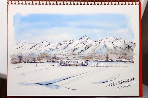 十勝岳と富良野線列車