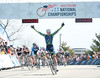 Kyle Knott as he crosses the finish line of the mens DII criterium