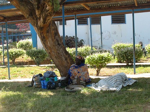 Patients resting under tree