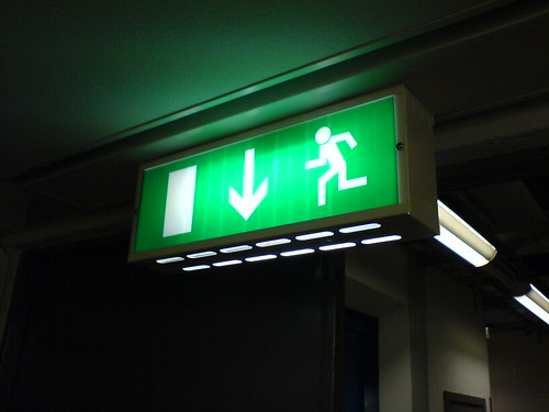 The famous green exit sign, pointing the way to freedom.