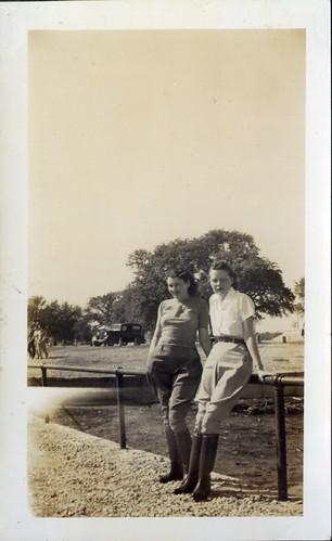 Two Women in jodhpurs at fence