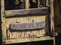 N.W.R.R. letterboard on locomotive cab of Mine Train thru Nature's Wonderland wreck display on the Rivers of America
