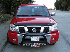 automobile(1.0), automotive exterior(1.0), sport utility vehicle(1.0), vehicle(1.0), nissan armada(1.0), nissan titan(1.0), nissan(1.0), bumper(1.0), nissan navara(1.0), land vehicle(1.0),
