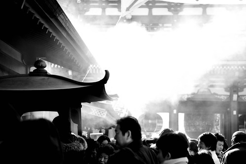 incense stick's smoke and an old temple's scenery
