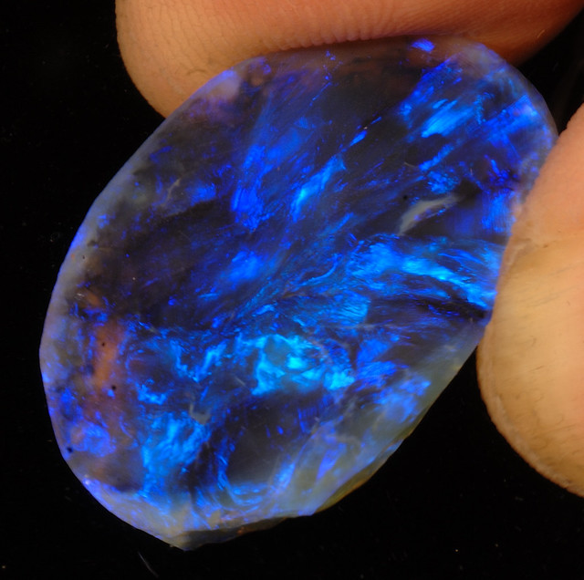 Hand-held Lightning Ridge Black Opal