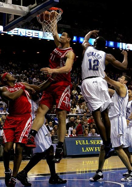 Yao Ming throws down a dunk over Orlando center Dwight ...