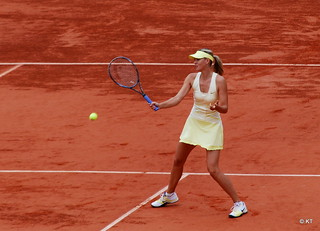 Maria Sharapova hits a forehand at the 2012 French Open. (Via Creative Commons, Carine06)