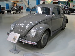 sedan(0.0), automobile(1.0), volkswagen beetle(1.0), automotive exterior(1.0), wheel(1.0), vehicle(1.0), automotive design(1.0), mid-size car(1.0), city car(1.0), compact car(1.0), volkswagen type 14a(1.0), antique car(1.0), land vehicle(1.0),
