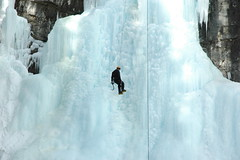Man scaling an icy mountain