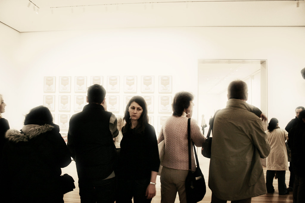 Museum Goers Viewing Andy Warhol's Campbells Soup Can Paintings