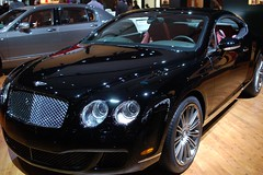 convertible(0.0), automobile(1.0), bentley continental supersports(1.0), executive car(1.0), wheel(1.0), vehicle(1.0), performance car(1.0), automotive design(1.0), bentley continental flying spur(1.0), auto show(1.0), bentley continental gt(1.0), bumper(1.0), personal luxury car(1.0), land vehicle(1.0), luxury vehicle(1.0), bentley(1.0),
