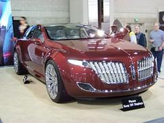 executive car(0.0), automobile(1.0), lincoln motor company(1.0), exhibition(1.0), wheel(1.0), vehicle(1.0), automotive design(1.0), auto show(1.0), land vehicle(1.0), luxury vehicle(1.0), supercar(1.0), sports car(1.0),