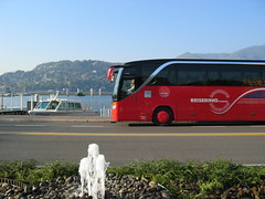Tour bus passing Lake Como, Italy