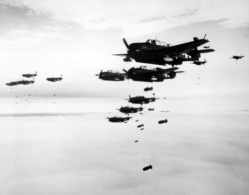 USS ESSEX based TBMs and SB2Cs dropping bombs