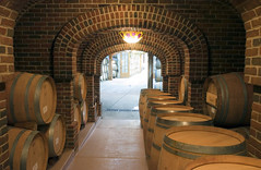 estate(0.0), wine cellar(1.0), arch(1.0), wood(1.0), room(1.0), barrel(1.0), winery(1.0),