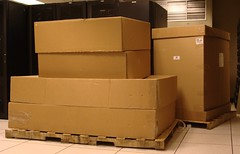 plywood(0.0), furniture(0.0), wood(0.0), wall(1.0), room(1.0), cardboard(1.0), carton(1.0), packaging and labeling(1.0), box(1.0),