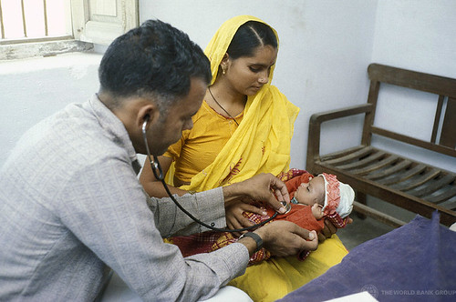 An infant receives a medical checkup