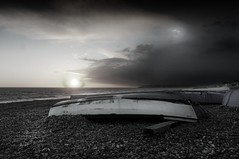 Clear or Stormy Sky at Sunset with fishing boats. Seaford, England.