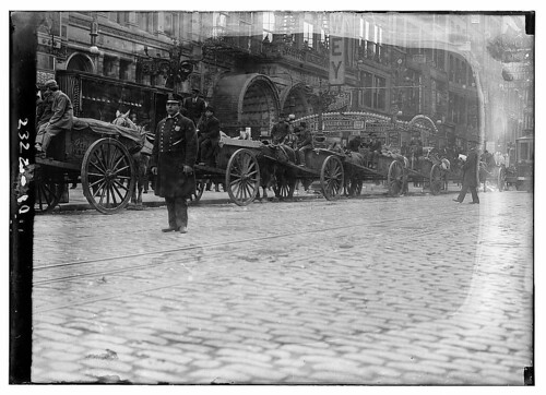 [Garbage carts protected by police during a strike, New York City]  (LOC)