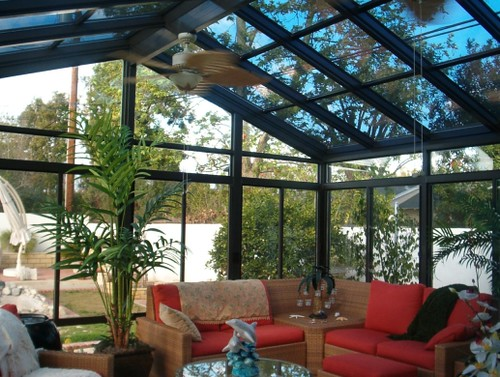 Green building with 4 seasons sunroom and vinyl windows for Building a four season room