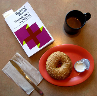 A doble, the book I am reading now and a bagel