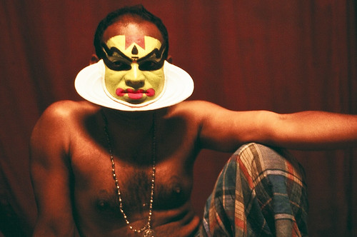 Kathakali artist partially made up