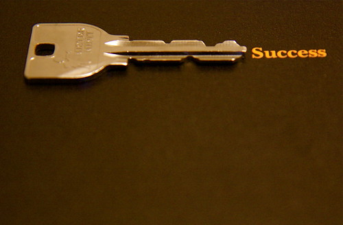 "Key next to the word ""success"""