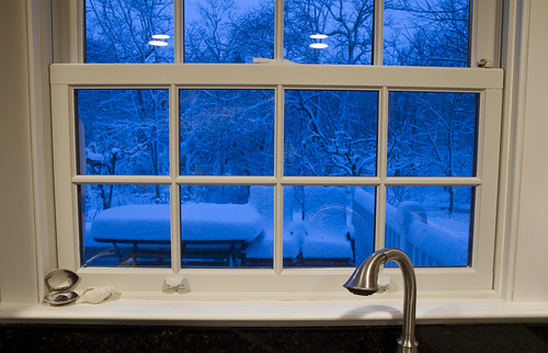 blue winter snow window look view lookingout outside cold wintry bottleblue kitchen snowfall white