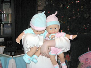 Anna Leigh Hides Behind her Christmas Dolly Twins, Daniel & Cutie.