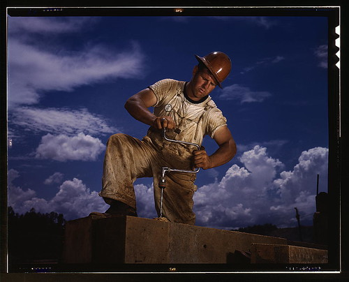 A carpenter at the TVA's new Douglas dam on the French Broad River, Tenn. This dam will be 161 feet high and 1,682 feet ong, with a 31,600-acre reservoir area extending 43 miles upstream. With a useful storage capacity of approximately 1,330,000 acre-feet