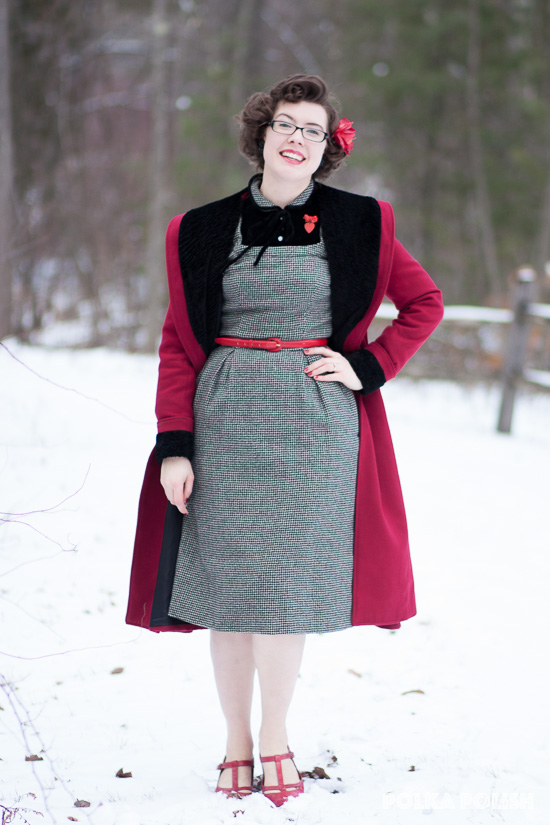 Red and black Hell Bunny Vivien coat over a vintage black and white checked wool wiggle dress paired with a valentine heart brooch and red accessories