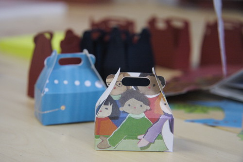 after the die cut...cute itty bitty boxes from recycled Christmas cards!