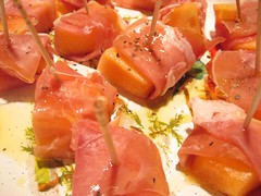 salmon(0.0), bruschetta(0.0), brochette(0.0), ham(0.0), hors d'oeuvre(1.0), meal(1.0), meat(1.0), prosciutto(1.0), produce(1.0), food(1.0), dish(1.0), cuisine(1.0), smoked salmon(1.0),