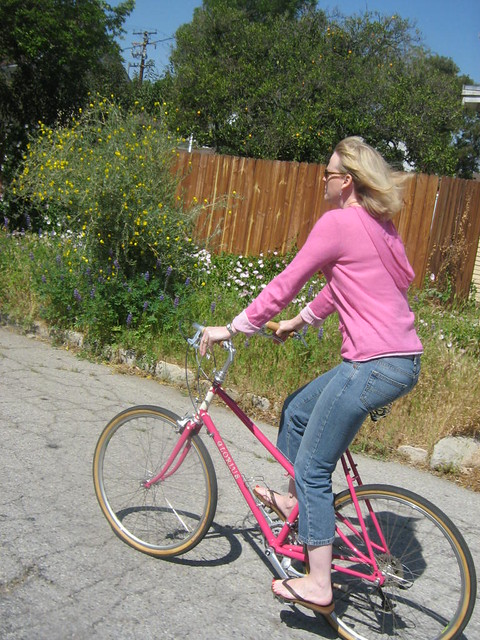 Her shirt almost matches the bike!