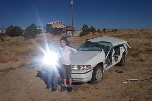 sun newmexico reflection car kids rural fun outdoors wreck galisteo