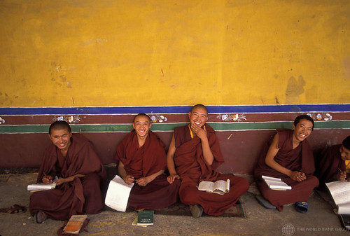 Monks sitting and laughing in China: © Curt Carnemark /World Bank