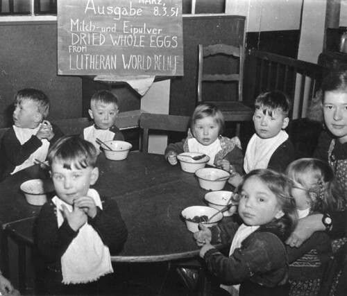 children sitting around a table eating