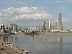 view of Panama City with many highrises and even more cranes. Looks like Miami.