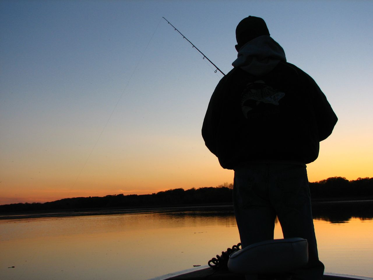Fishing time bass fishing time in the seaside at evening for Bass fishing times