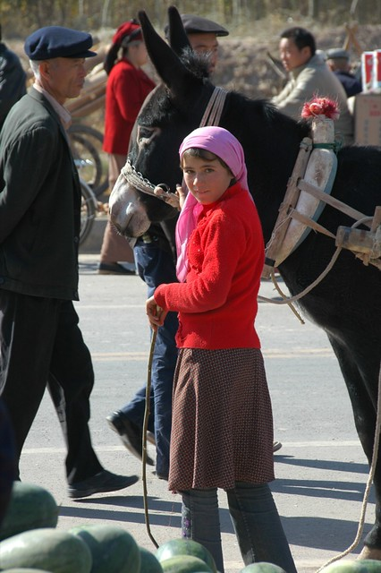 Uighur Girl and Her Donkey - Kashgar, China