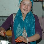 Uighur Woman Chopping Onions - Kashgar, China