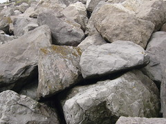 stone wall(0.0), wall(0.0), outcrop(0.0), flagstone(0.0), boulder(1.0), rubble(1.0), limestone(1.0), igneous rock(1.0), geology(1.0), bedrock(1.0), rock(1.0),