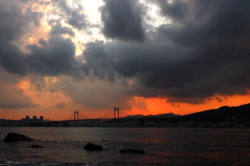 bridge sunset sea sky water clouds fire nikon korea busan naturewatcher afs287028d