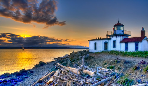 seattle blue windows sunset red sky orange lighthouse mountains cold beach water glass silhouette yellow clouds sailboat reflections island nikon rocks waves windy pebbles dirt driftwood pugetsound olympics hdr gitzo discoverypark westpoint seagrass d90 giottos top20lh moog55