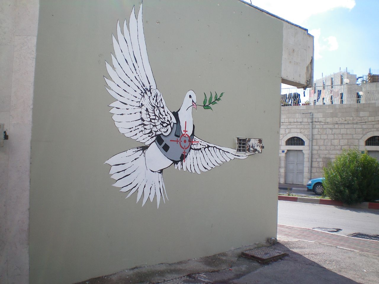 An armed peace dove wearing riot armor