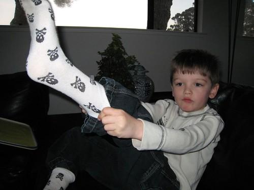 putting on socks, bedhead, skull and crossbones IMG_0943