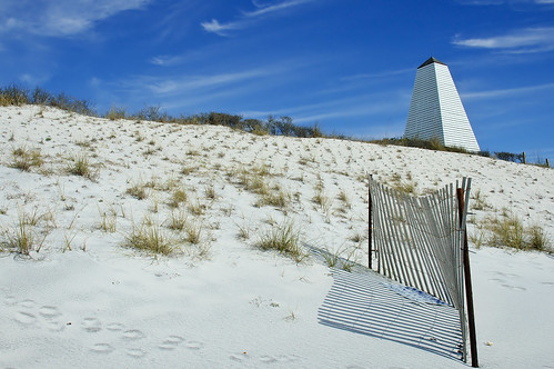 white clouds coast seaside sand florida dune obelisk pavilion walton highway30a
