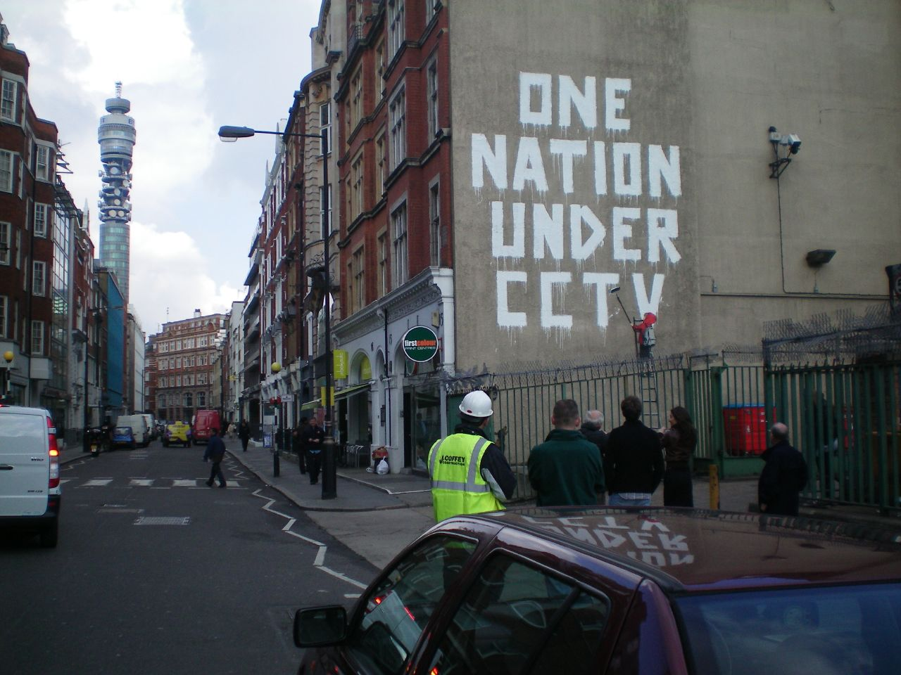 One Nation Under CCTV graffiti on a wall
