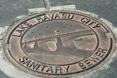 ancient history(0.0), commemorative plaque(0.0), number(0.0), archaeological site(0.0), manhole(1.0), manhole cover(1.0),